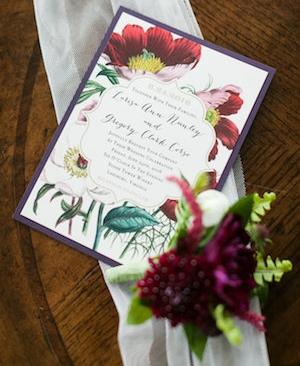 The invitation helped to set the mood right away. Greg's boutonniere had Sword Fern in it. Photography by Candice Adelle.