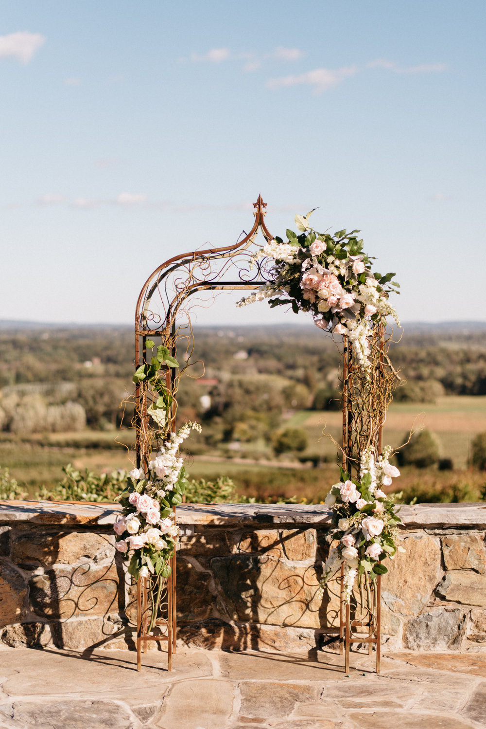 Rental arch with partial florals, photography by Chris Glenn.