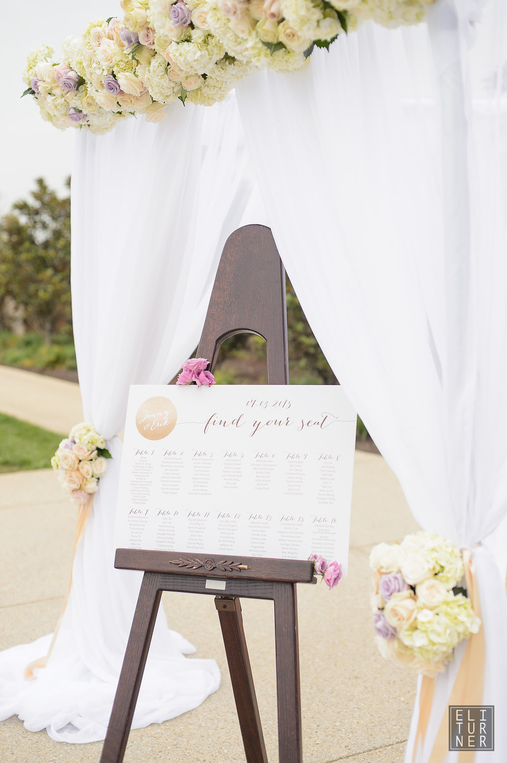 Rental arch with full drape and floral tiebacks, photography by Eli Turner.