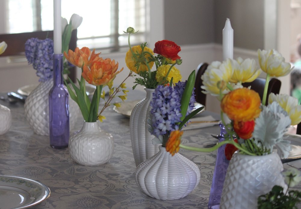 White vases in basket weave and geometric designs are a sleek and modern with a vintage feel.