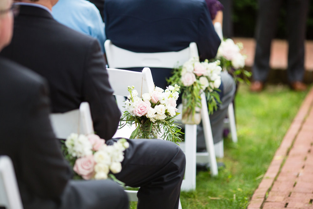 Lepold-Johnson-Ceremony-pew-arrangements.jpg