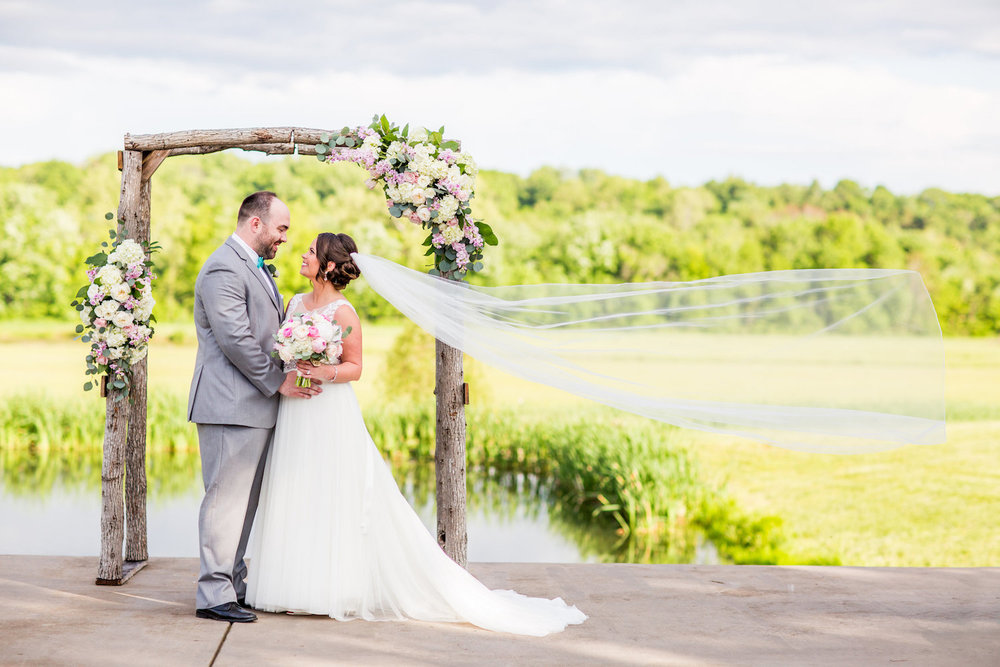 This is an on-site arch at Riverside on the Potomac. This is a partial floral arch. Photo by KayPea Photography.