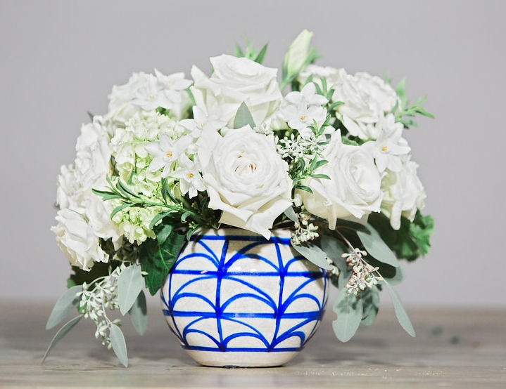 """Waking"" includes Paperwhite and Lisianthus, two unique varieties in a geometric patterned vase."