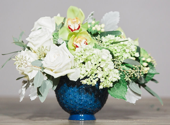 """Snow"" is the smaller of the two arrangements in the blue Pierre Compote."