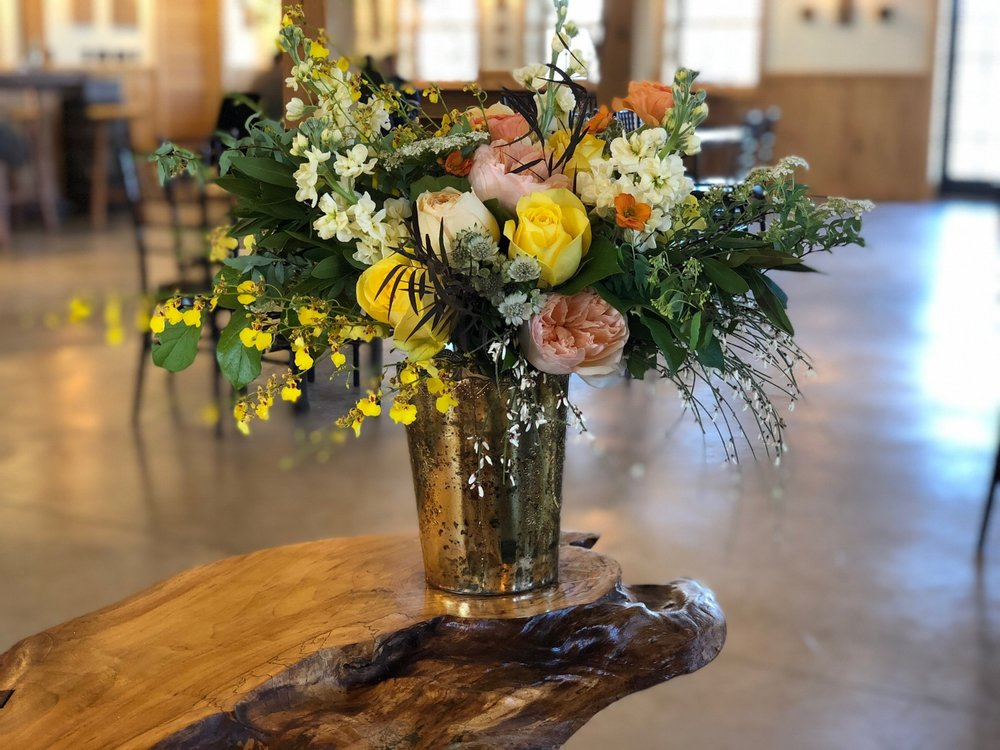 This bridal bouquet was placed on the head table in a gold vase. Many of the flowers were used as focal flowers in the installation at  Mt Defiance Cidery and Distillery .