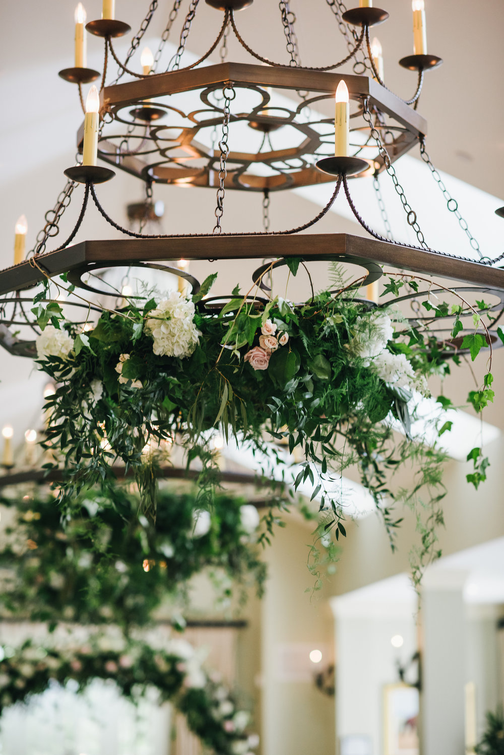 Hanging chandeliers and a circular arch at Salamander Resort and Spa. Photography by Chi Chi Ari.