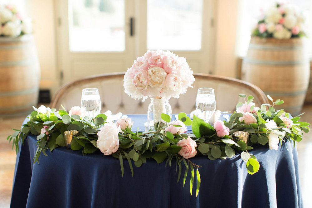 Candice Adelle Photography   , navy linens with pink and white flowers and the bridal bouquet.