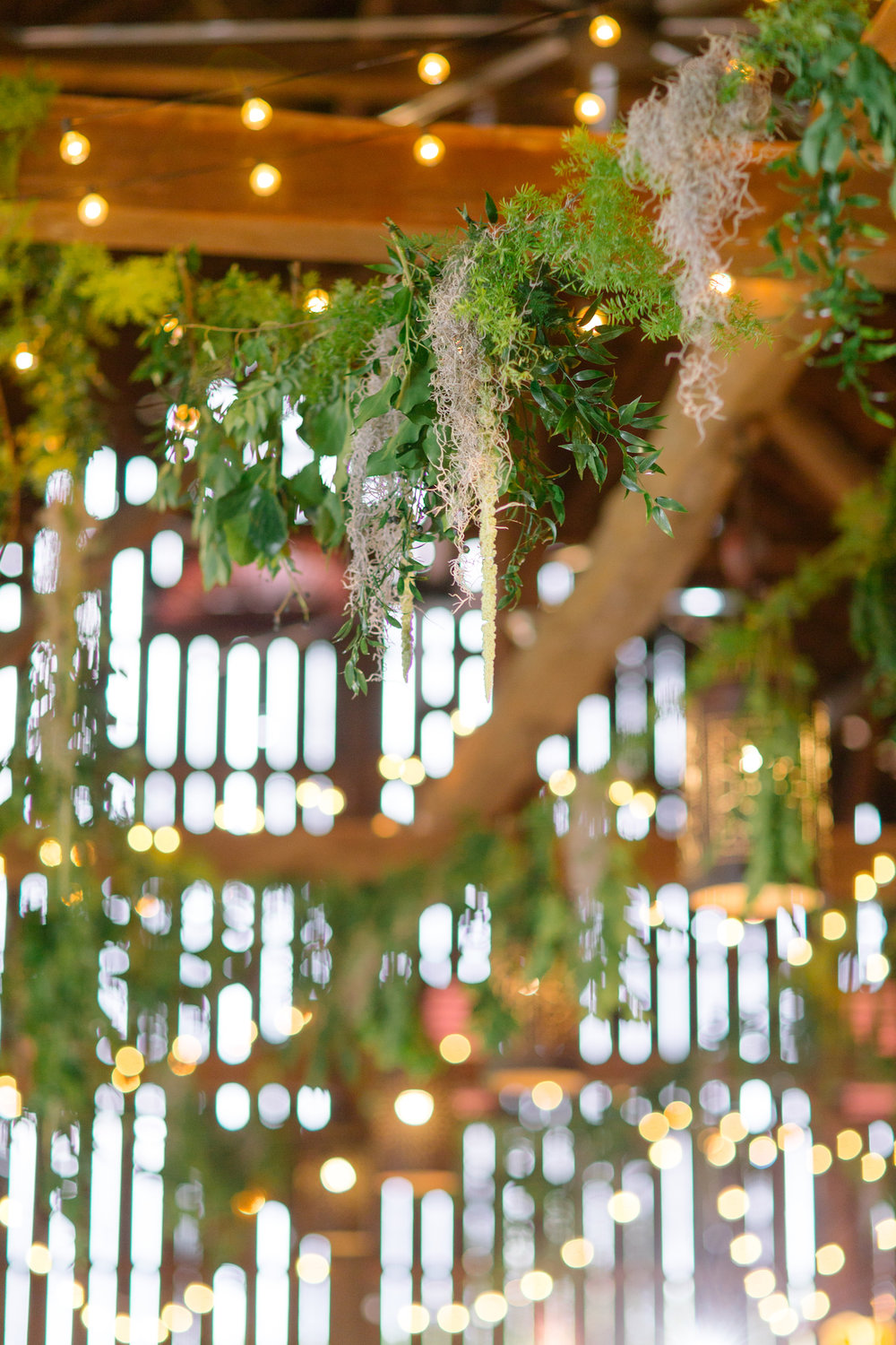 Sarahbethphoto-hanging-greenery-riverside-on-the-potomac-barn-rafters-jmorrisflowers.jpg
