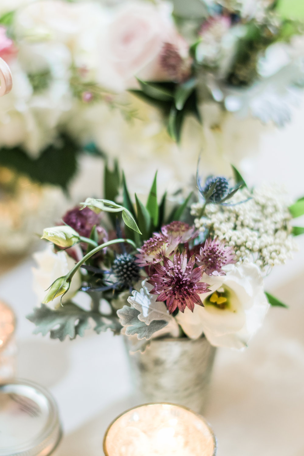 Stephanie-messick-steph-silver-votive-blue-mauve-grey-white-flowers-stone-tower-winery-jmorrisflowers.jpg