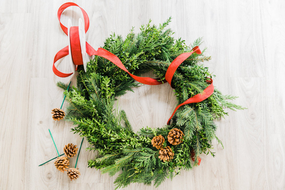 Jmorrisflowers-ribbon-pine-cones-wreath.jpg