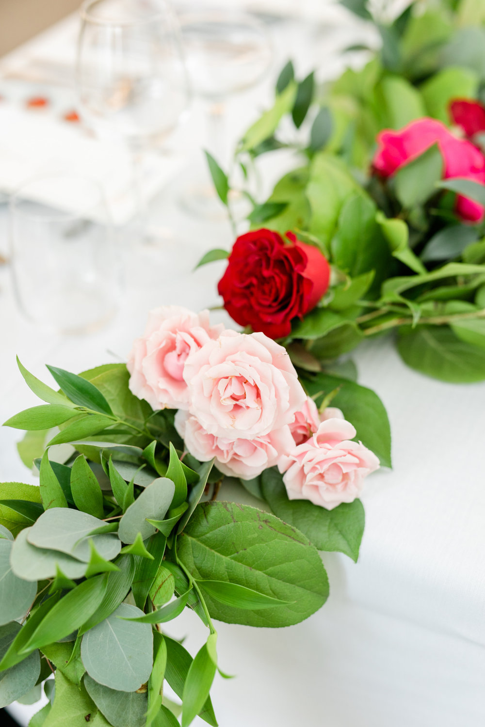 Megan-Kelsey-pink-red-garland-greenery-jmorrisflowers.jpg