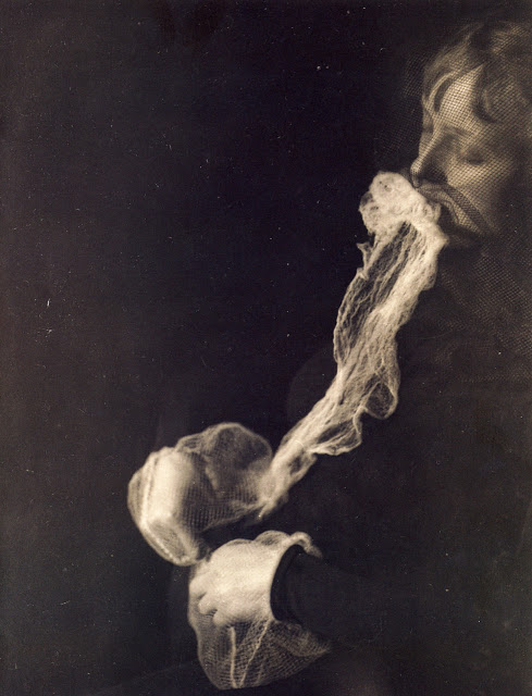 The medium Stanislawa P: emission and resorption of an ectoplasmic substance through the mouth. Albert von Schrenck-Notzing, silver gelatin print, 1913.
