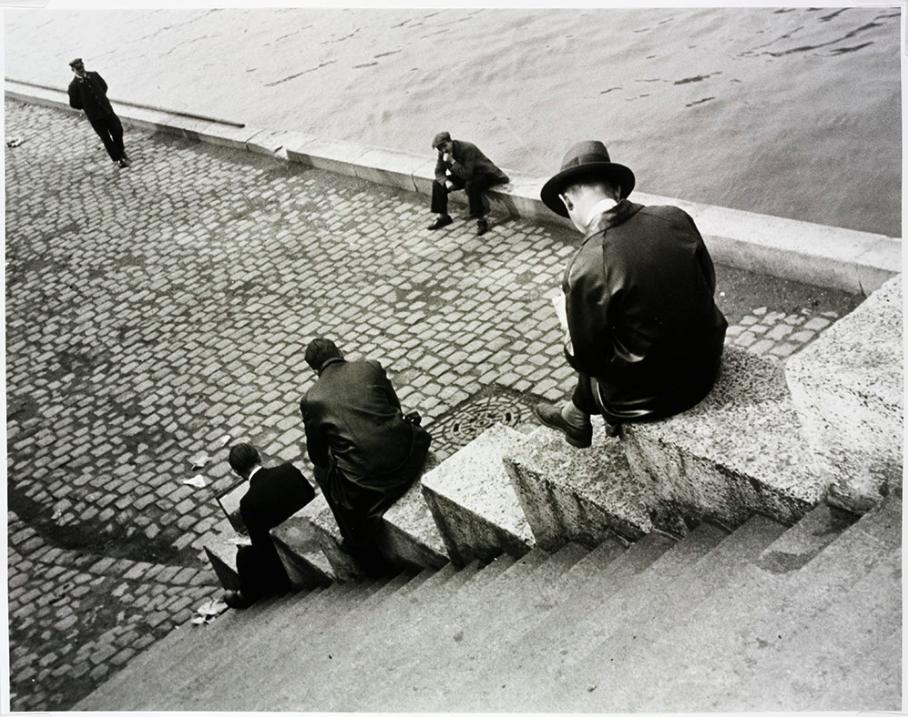 Three men on steps by the Seine ,1931.