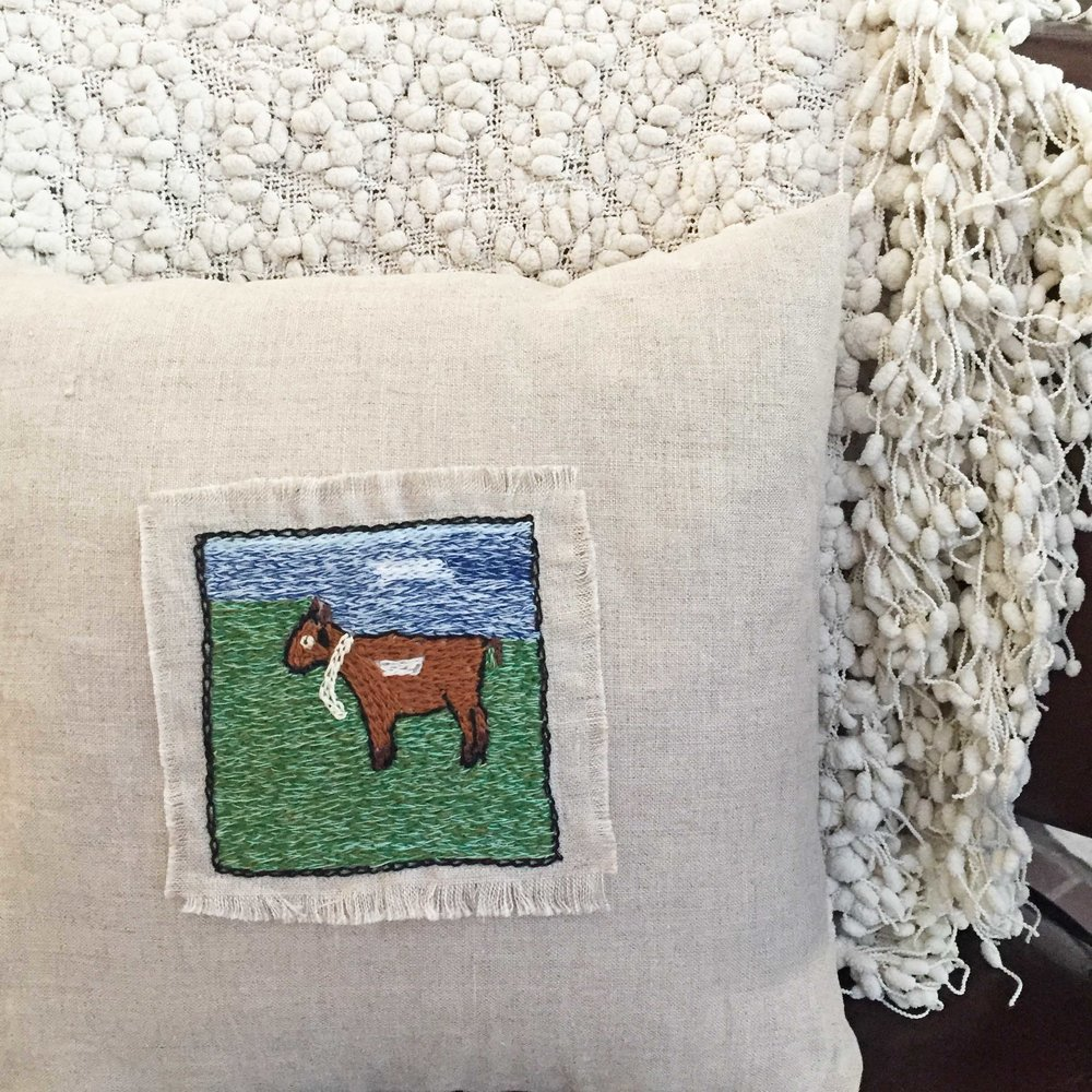 12 x 12 inch linen goat pillow hand-embroidered by Yemimah in Uganda.