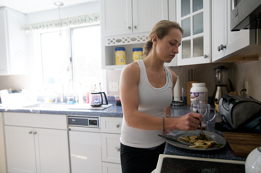 Lauren eats a meal of egg whites and asparagus, a diuretic. At this point in her training, Lauren has not consumed carbohydrates in five days and is consuming about a thousand calories a day. Eating every three hours, four to five times a day, helps maintain her metabolism.
