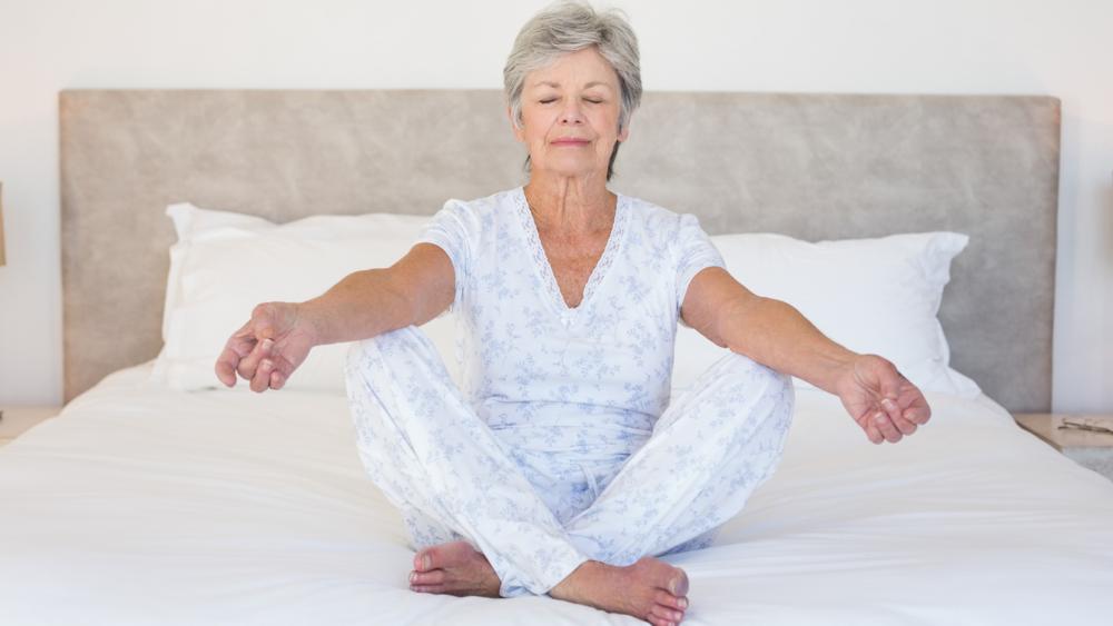 2880photodune-8554304-full-length-of-senior-woman-meditating-in-bed-at-home-l.png