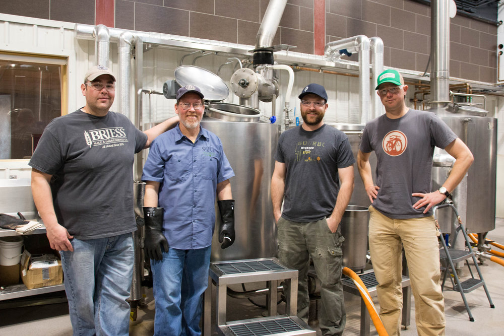 Representatives from New Belgium Brewing Company and Odell Brewing Company crafting their Experimental pale ale for Collaboration Fest. From left to right: Zach Baitinger (New Belgium), Scott Dorsch (Odell), Brent Cordle (Odell), Christian Holbrook (New Belgium). Photo by Tyra Sutak