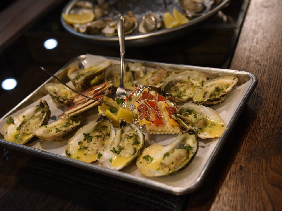Wood-grilled oysters with garlic butter and parmesan at Oskar Blues Grill & Brew. Photo courtesy of Bobbie Turner Photography