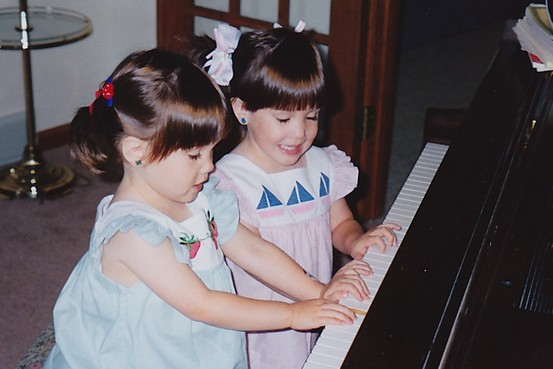 Christina (in blue) and Michelle (in pink) Naughton playing as children. (Photo courtesy of Naughton family)