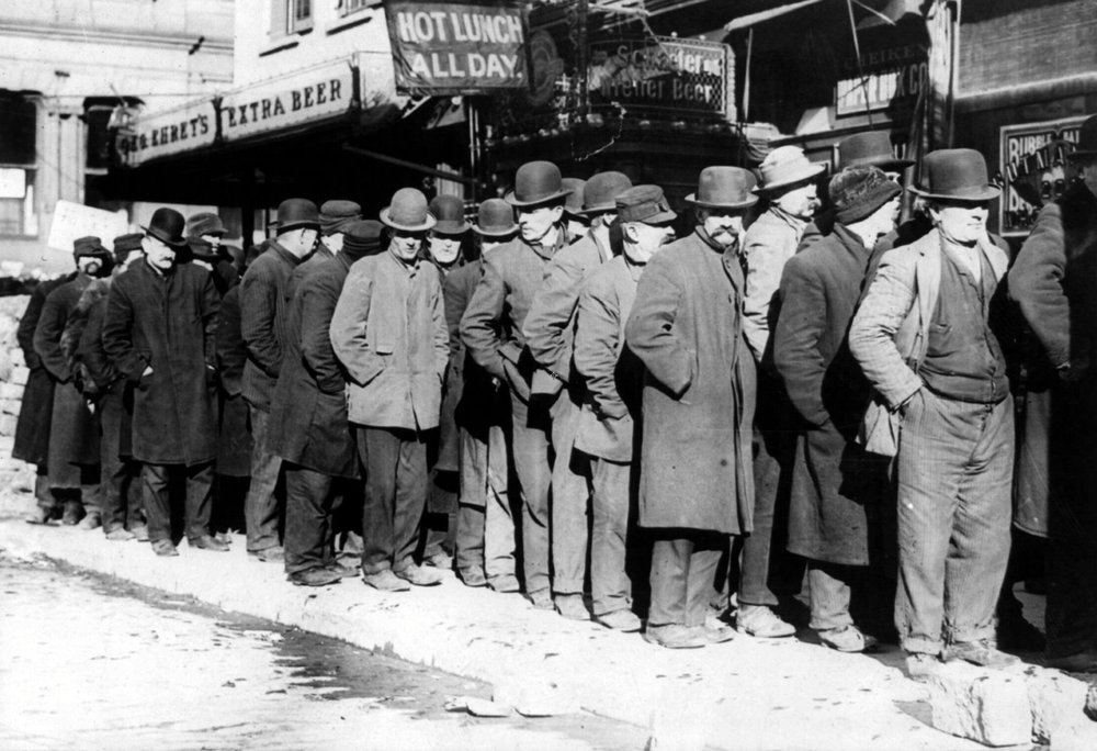 Bowery men waiting for bread in bread line, New York City, Bain Collection