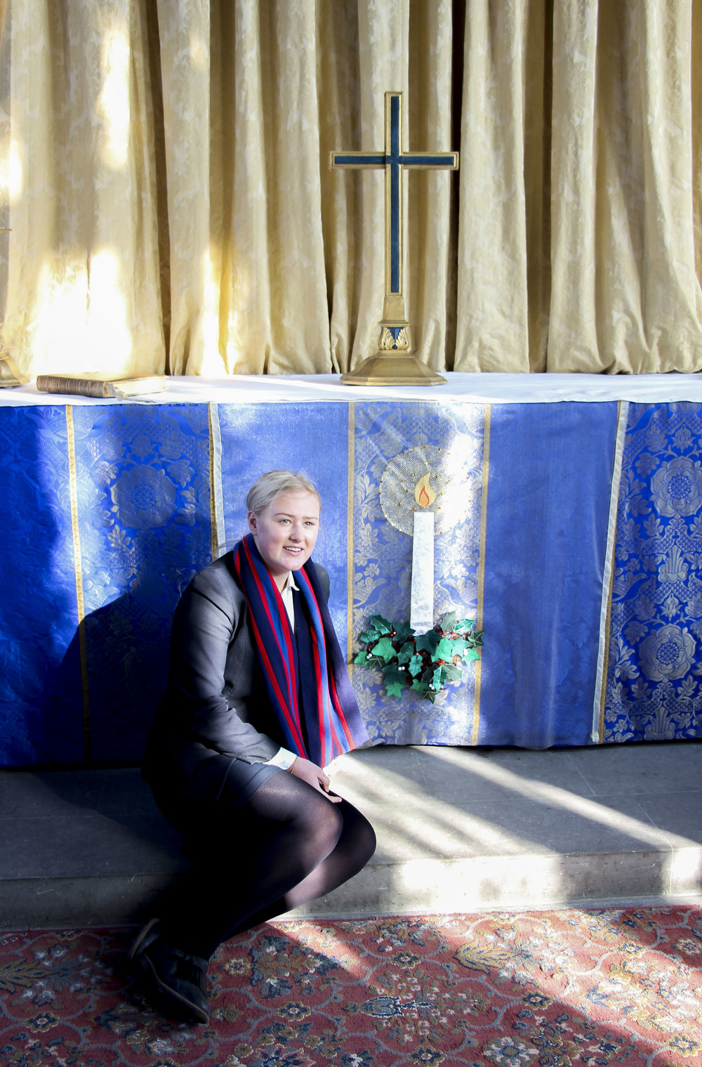 Megan Conway by the Alter front she created.  Picture by Edward Chalmers.