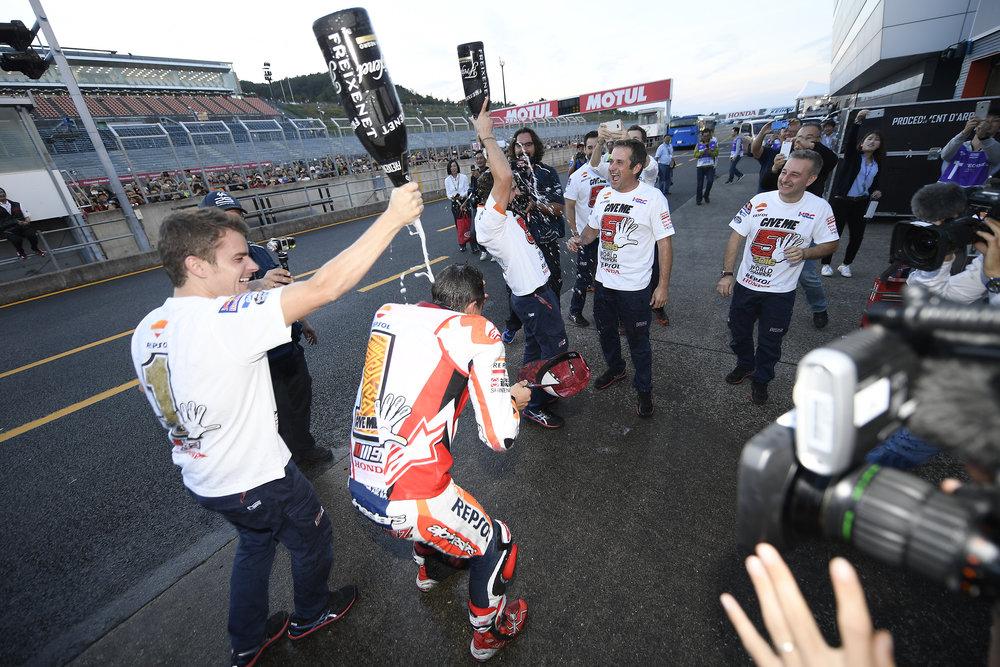 2016-motogp-world-champion-marc-marquez-and-team.jpg