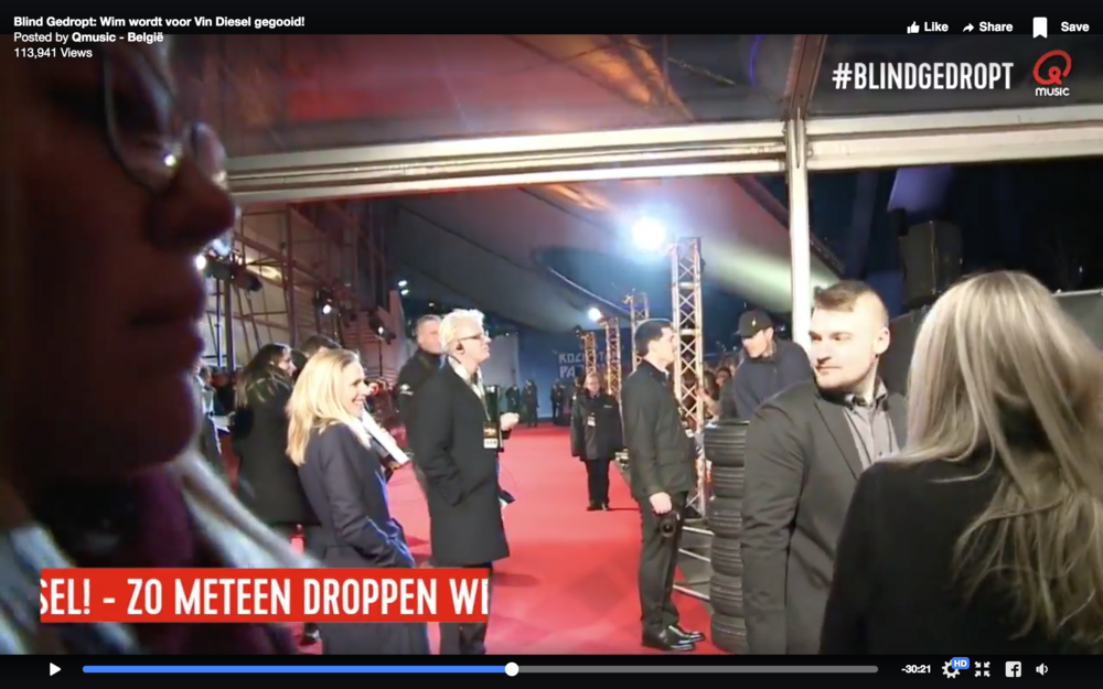 Appearing in the background of a Belgian station's red carpet video.