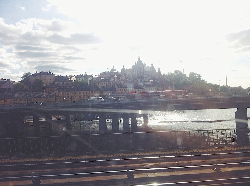 My favorite thing to look at in Stockholm. View from train at Gamla Stan, looking out onto Söder Mälarstrand. Love the buildings built into a hill, with pretty pointed roofs. Plus, the way the water below glistened in the sun was just….