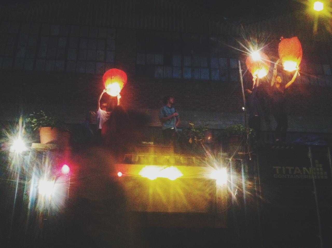 Making wishes on lanterns.