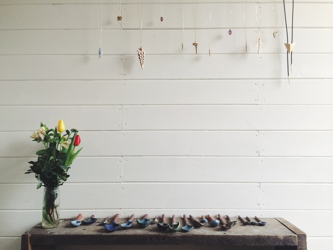 Shop bits: Spoons by Kana., Arrow Necklaces, and British-grown flowers by Cook and Carlsson.