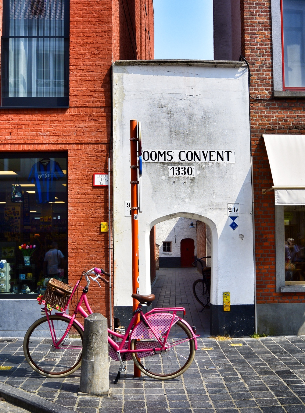 Pink Bicycle and Convent entrance in Bruges
