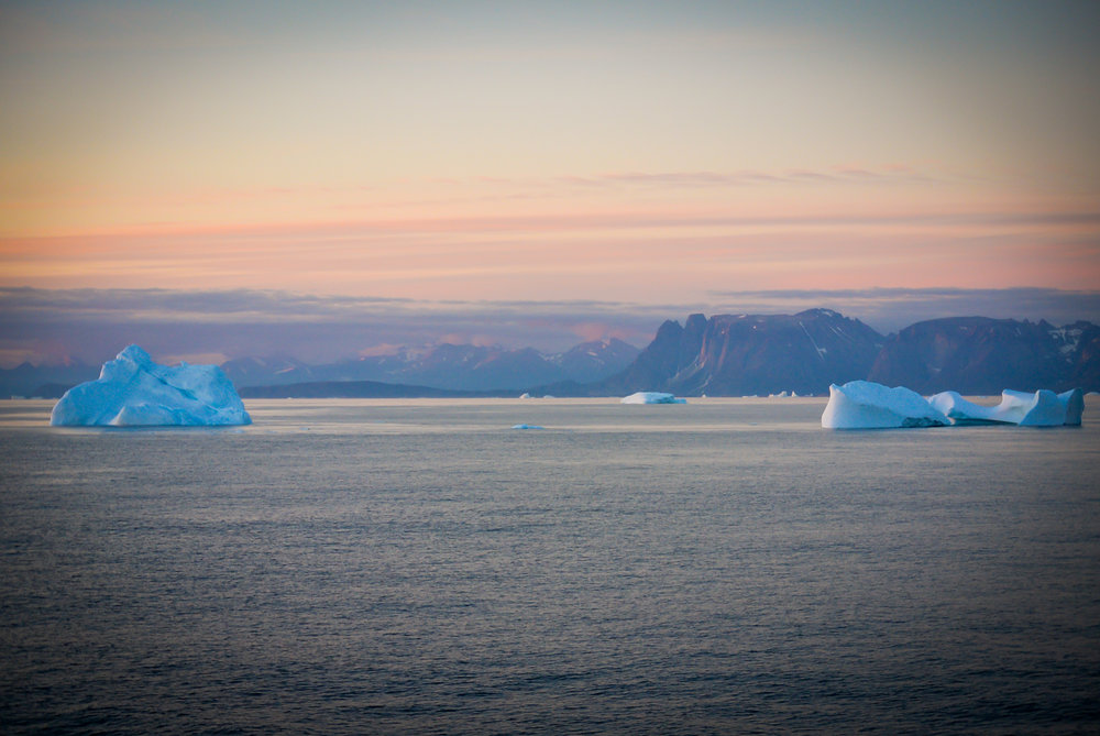 Icebergs at sunset off the coast of Greenland