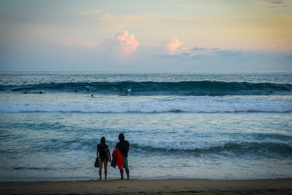 Surfers at dusk in Oaxaca
