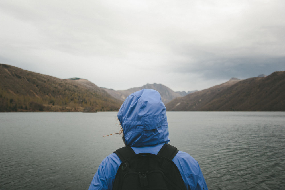 Female backpacker staring out over lake