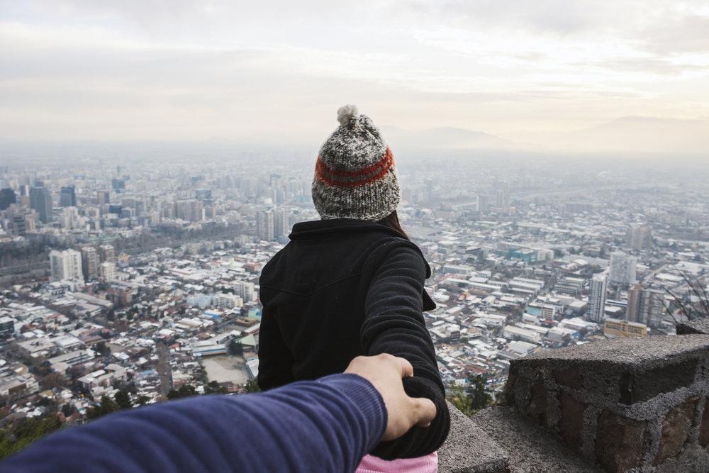 Female traveler holding hands