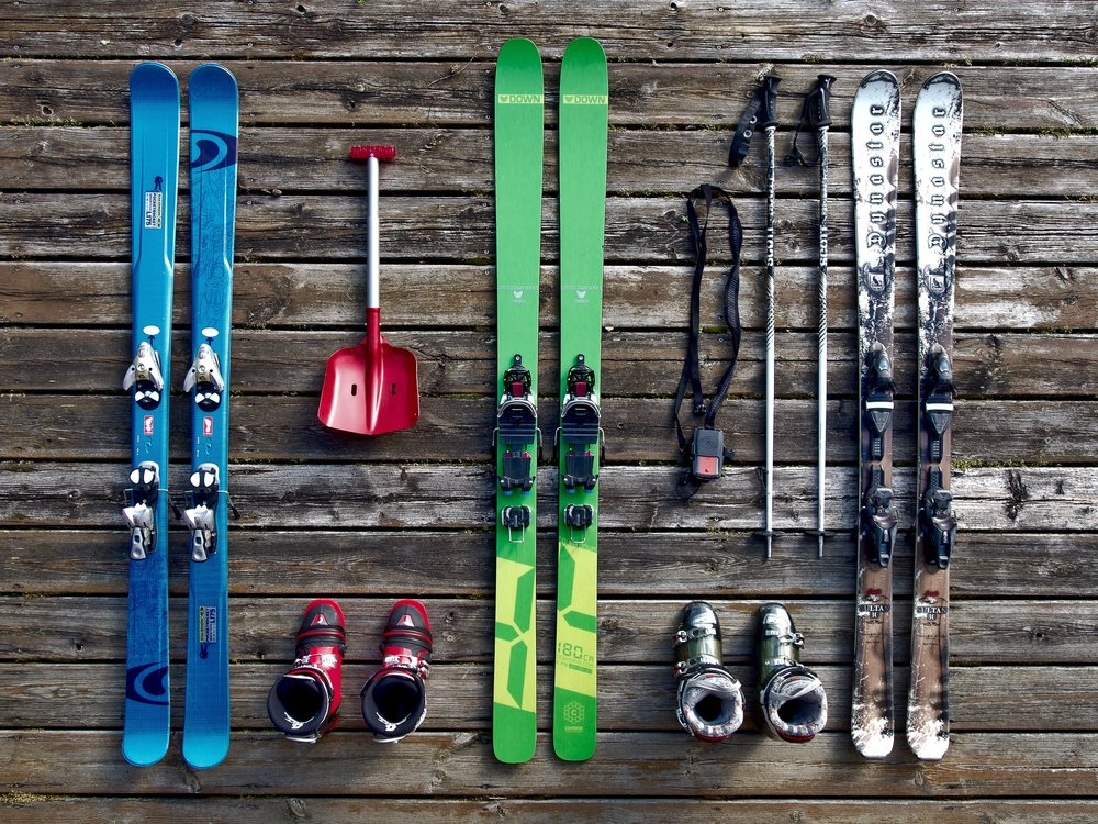 Skiis, boots, poles, and accessories