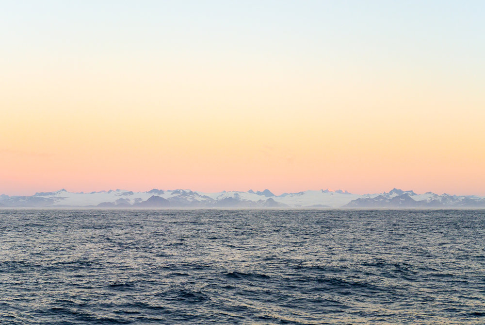 Icy pink sunrise off the coast of southern Greenland