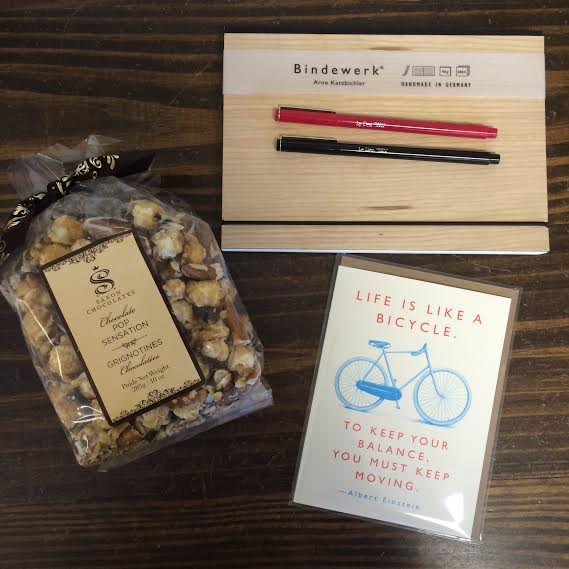 Package A: Our men's package! A Binderwerk notebook/ journal, Chocolate Pop Sensation, 2 Le Pens and a greeting card. ($60)