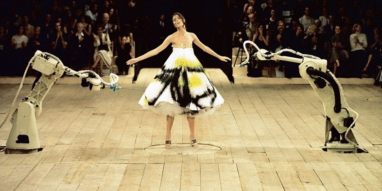 Model Shalom Harlow in the Alexander McQueen's No. 13 fashion show, in 1998, in London.