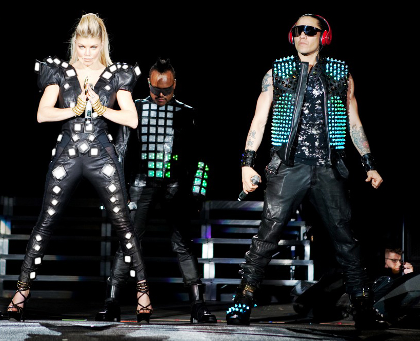In 2011, designers Nancy Tilbury and Benjamin Males founded Studio XO in London. This fashion tech laboratory has designed interactive clothing for american group The Black Eyed Peas, here in June 22, 2011, at the Stade de France in Paris, for the premiere of The Beginning Massive Stadium Tour. From left to right, singers Fergie, Taboo and apl.de.ap, in the background.