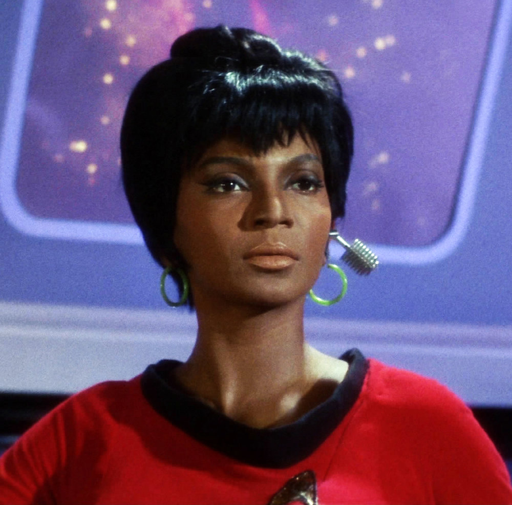 Nyota Uhura (Nichelle Nichols), communication officer, uses wearables, like those silver cylindrical wireless headphones.