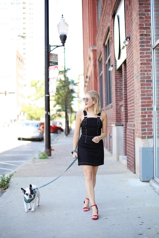 girl walking smiling denim dress french bulldog