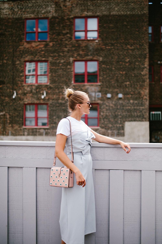 blue jumpsuit city view girl bun