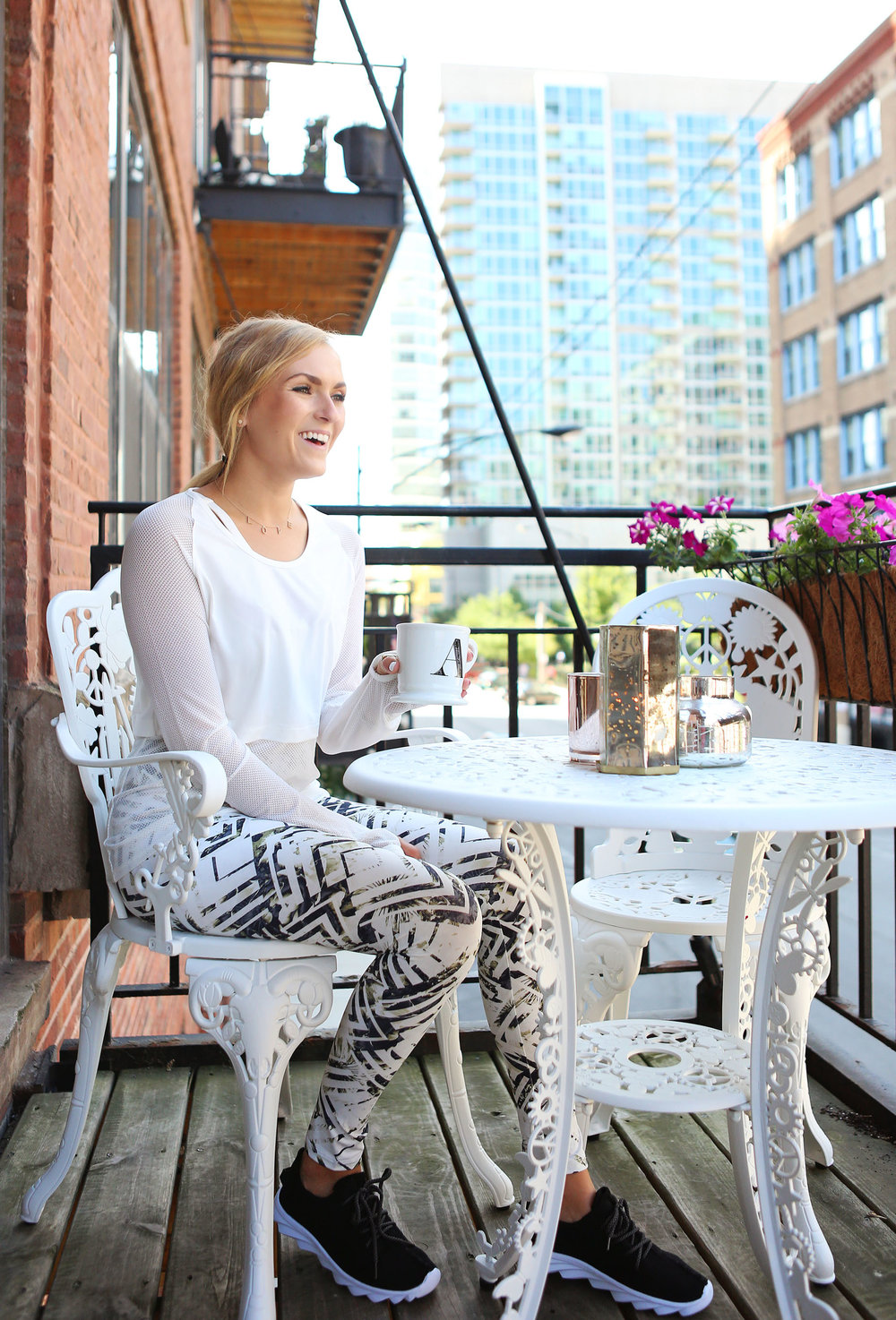 girl smile workout clothes balcony