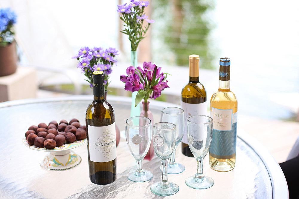 entertaining spread wine treats flowers