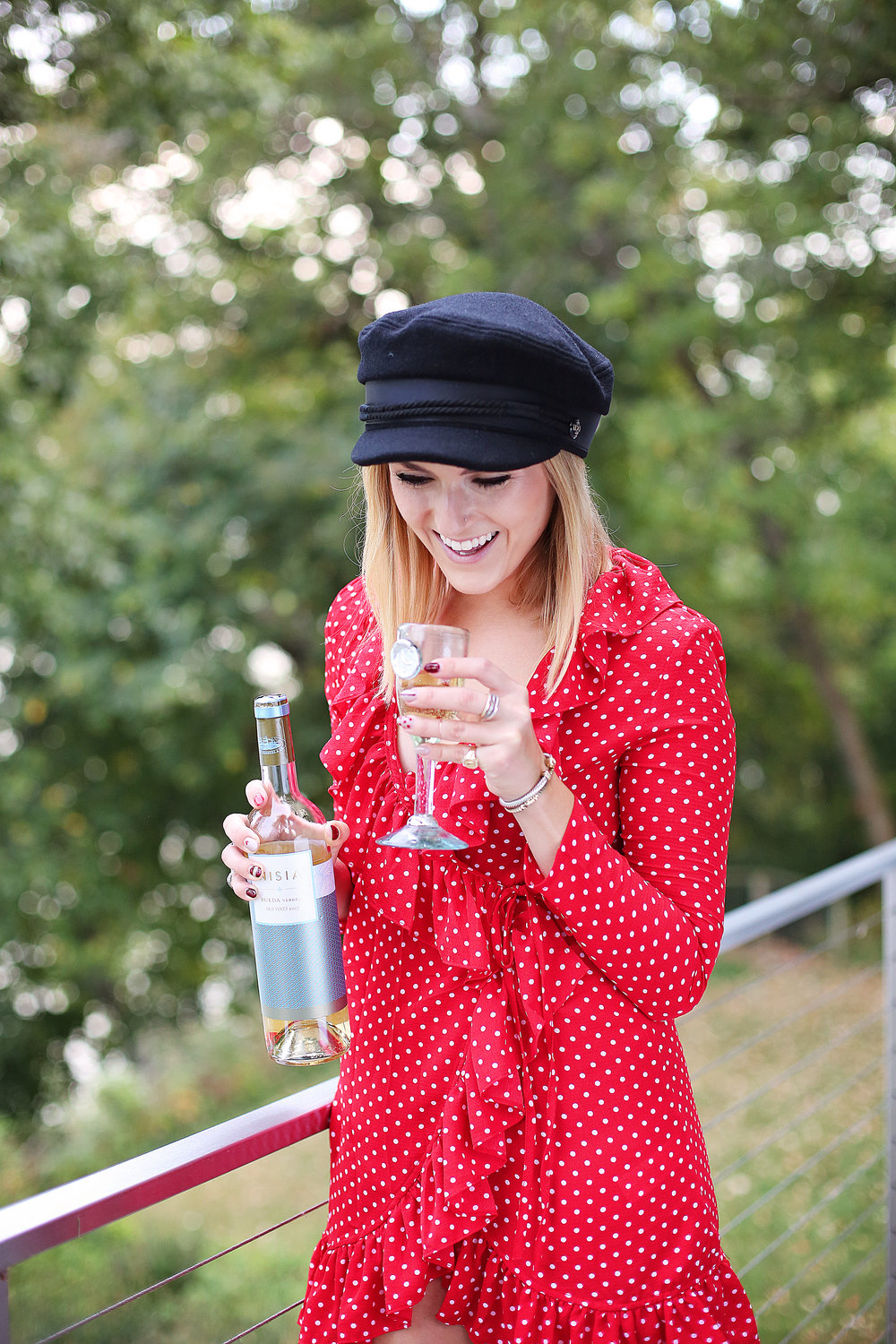 girl smile red dress white wine black hat