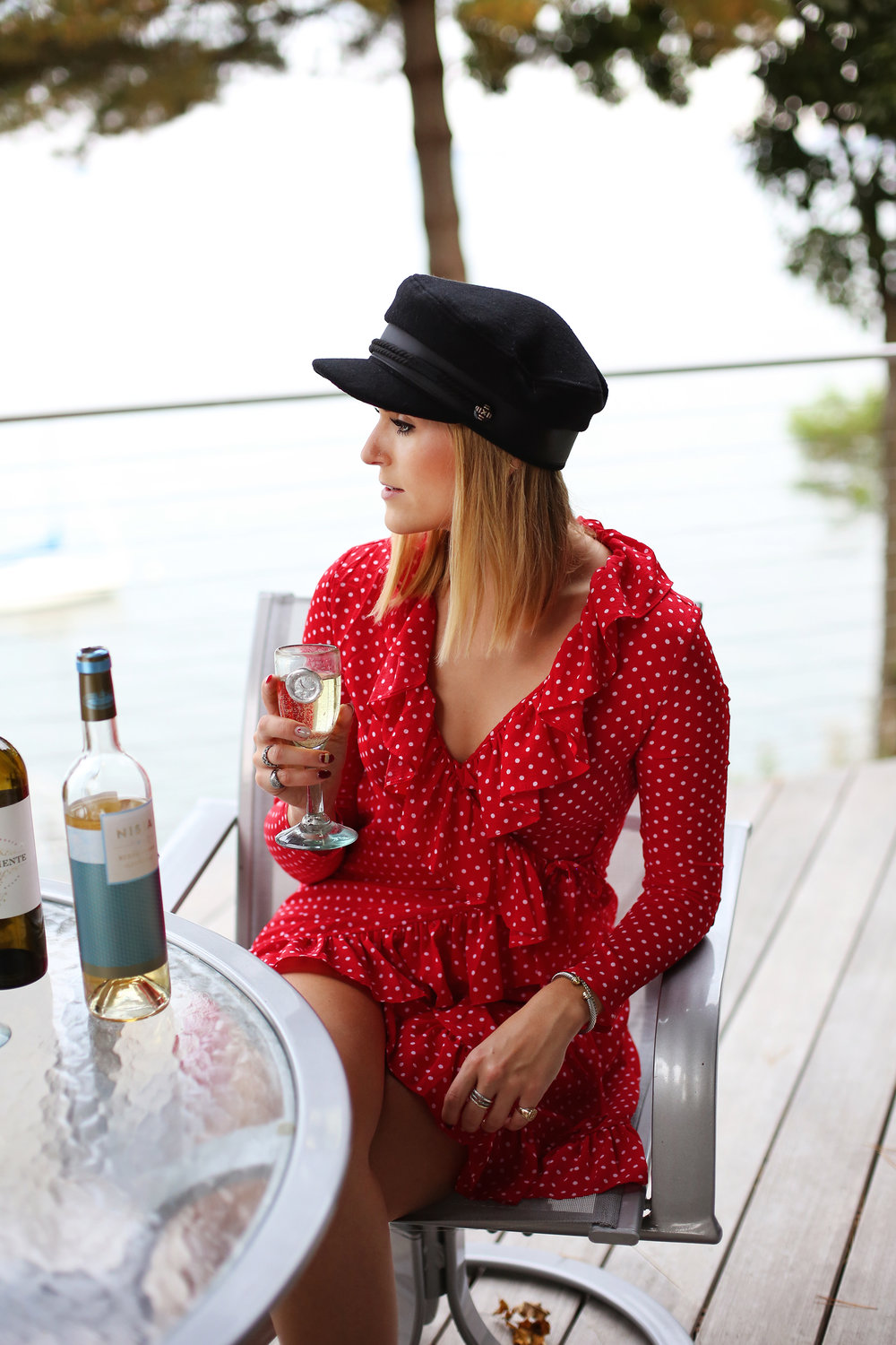 girl drink white wine red dress