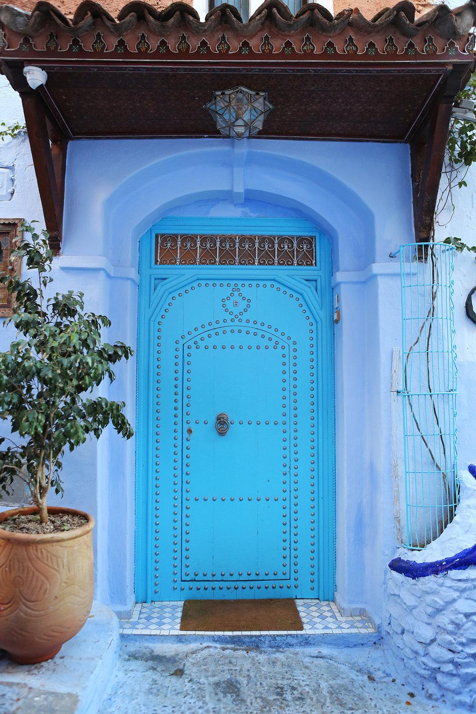blue door chefchaouen morocco