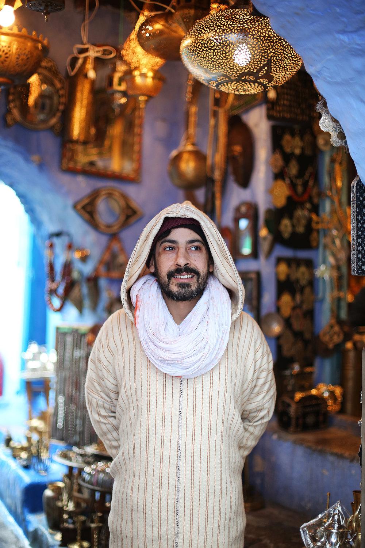 artisan shopkeeper in chefchaouen morocco