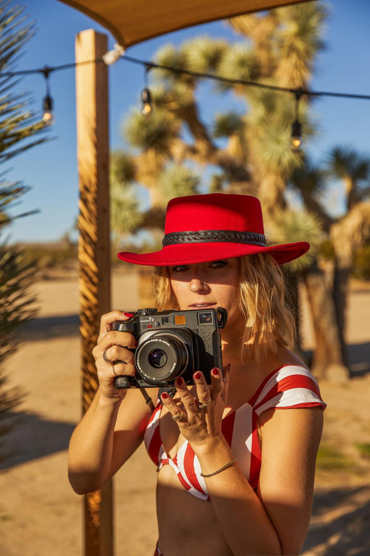 girl behind camera